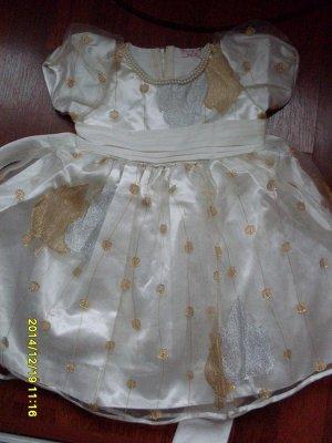 Нарядное платье с золотой и серебряной отделкой