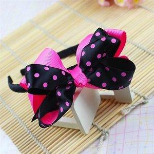 Ободок с двухцветным бантом в горох черно-розовый