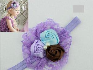 Повязка на голову с розочками фиолетовая