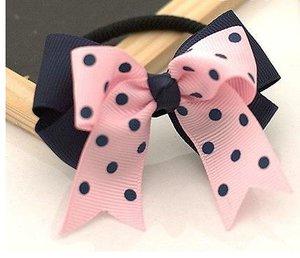 Резинка для волос с двойным сине-розовым бантиком в горох
