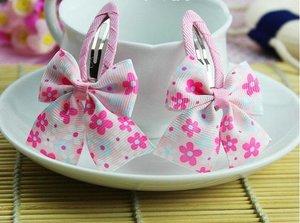 Зажим для волос клик-клак с розовым бантиком в цветочек
