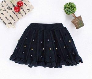 Вязаная юбка, декорирована бисером.
