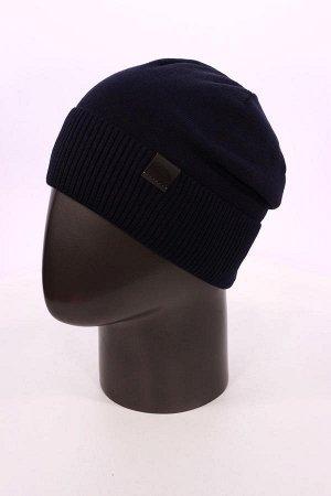 синий Состав:50% wool, 50% polyacrylic Мужская зимняя стильная шапка с кожаным ремешком-застежкой сзади. Гладкая вязка из качественной шерсти, широкий практичный рельефный отворот. Внутри утепленная