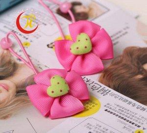 Резинка для волос с бантиком и сердечком внутри розовая
