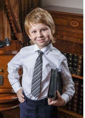 Галстук Артикул: Галстук Ткань:  Состав: 100% полиэстер Описание: Галстук в полоску для мальчика, на резинке и застежке. Размер 35 см. В упаковке 5 штук. Цена за 1 шт