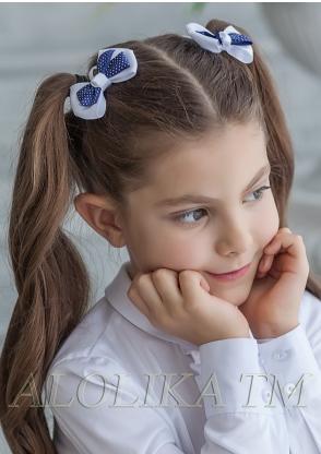 Заколка Ткань: Репсовая лента Состав: 100% полиэстер Описание: Очаровательный заколка-бантик на зажиме для девочек. На зажиме. Диаметр 7 см.