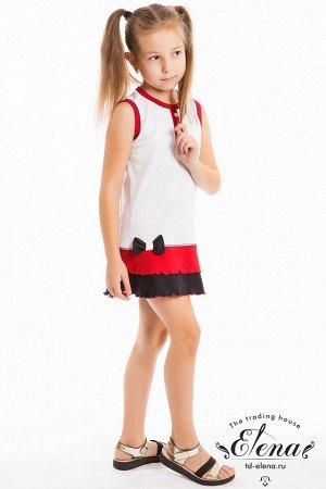 Сарафан Сарафан детский пошит из интерлока комбинированных цветов, с застежкой на кнопки сзади, и оборками по низу, горловина и проймы обработаны широкой бейкой, спереди с планкой у горловины и бантом