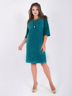 Платья Платье полуприлегающего кроя, комбинированное из замшевой ткани и трикотажа спокойного оттенка. Вырез горловины круглый. Втачныерукава прямые, длиной 3/4.Модель отрезная по линии груди и бедр