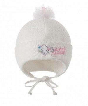 Шапка Двухслойная шапка с отворотом, с завязками из капитона на подкладке из кулирки (хлопок 100%). Декорирована вышивкой и помпоном из фатина с атласной лентой в верхней части колпака.