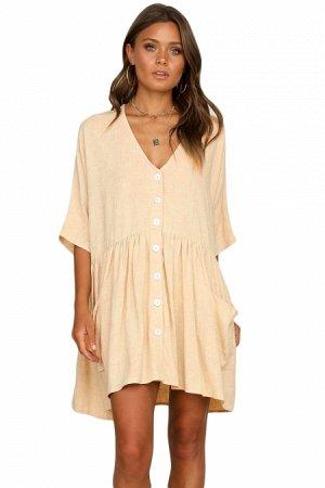 Бежевое свободное платье-трапеция с белыми пуговицами и широким воланом