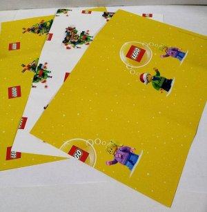 LEGO плотная фирменная упаковочная бумага - 3 листа с разными рисунками (2 желтых и 1 белый) с размерами каждого 80см на 60см. В вакуумной упаковке.