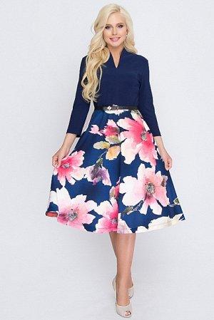 Платье Комбинированное платье из трикотажа.Юбка отрезная клеш.Принт юбки купонный. Ремень в комплект не входит.  Состав: 30% вискоза 65% п/э,5% эластан