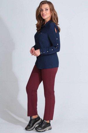Рубашка Рубашка Golden Valley 26421 темно-синяя  Состав ткани: Вискоза-100%;  Рост: 170 см.  Блузка с центральной застежкой на петли и пуговицы, втачным воротником с отрезной стойкой. По переду с наг