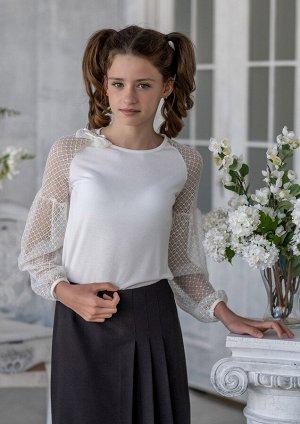 Грезе Совершенно очаровательная, легкая блузка для девочки старшего школьного возраста. Рукав присобран между плечом и локтевым сгибом окантован. Блузка идеальна в сочетании с сарафанами. Воротник окр