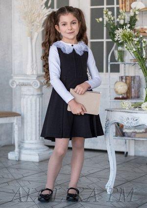 Умница Практичный сарафан для девочек школьного возраста. Сарафан на подкладе, украшен застроченными складками по переду, ремень в комплект не входит.