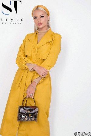 Плащ 54013 Артикул: 54013; Материал: Плащевка+подклада; Цвет: Желтый; Размер на фото: S; Параметры модели: 89-58-87; Рост модели: 164 Суперстильный плащ– необходимый предмет женского арсенала для дем