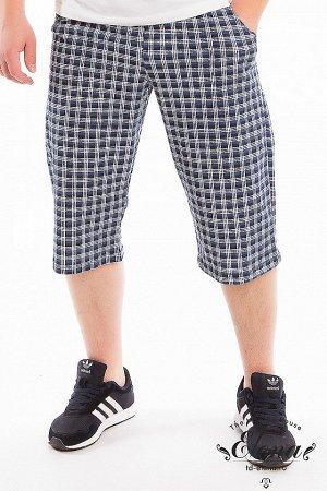 """Капри Капри мужские выполнены из хлопкового полотна с набивным рисунком """"клетка"""", прямого свободного кроя, с двумя карманами по бокам. Пояс на резинке. Размерный ряд: 44-70. ВНИМАНИЕ!!! На данную моде"""
