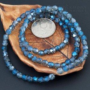 Хрустальные бусины имитация Сваровски, бочонки бесцветные с синим напылением, р-р 6мм, отв-е 1мм, в нитке 100 бусин.