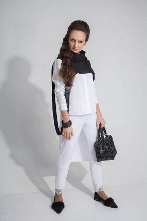 Костюм Костюм ElPaiz 394 черно-белый  Рост: 164 см.  Комплект женский, состоящий из блузки, брюк и накидки-капюшона. Блузка прямого силуэта с застежкой на петли и пуговицы на планке. Рукав втачной с