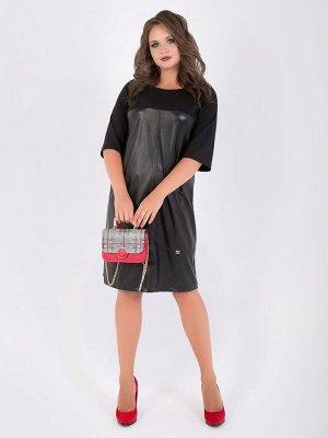 SALE  ! Стильноеплатье полуприлегающего силуэтавыполнено из комбинированных тканей: экокожи и трикотажа. Круглая горловина с внешней обтачкой. Втачные рукава длиной 3/4 , кокетка и спинка платья вып