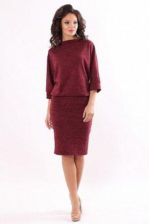 Платье Платье из плотного меланжевого трикотажа.Лиф платья объемный,с цельнокроеным рукавом и большим напуском по линии талии. Юбка платья прямая,узкая,по спинке со шлицей.  Состав: 30% вискоза 65% п