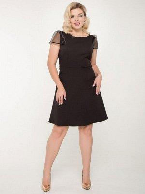 Платье Изящное черное платье из трикотажного полотна прилегающего силуэта с рукавом из органзы. - однотонная расцветка - отрезное по талии - горловина круглая на бейке - открытая пройма - в рельефа
