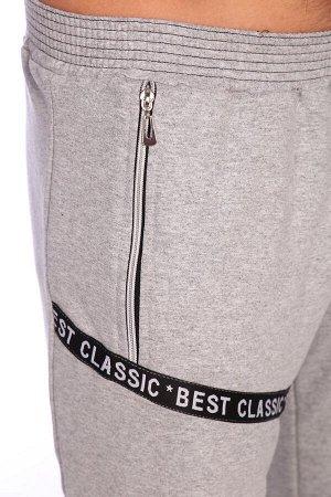 Шорты 1489 хлопок-72%, полиэстер-20%, лайкра-8% Оригинальные мужские шорты асимметричного кроя. Пояс эластичный, два разных кармана по бокам, на передних половинках декоративная лента и тесьма-молния.