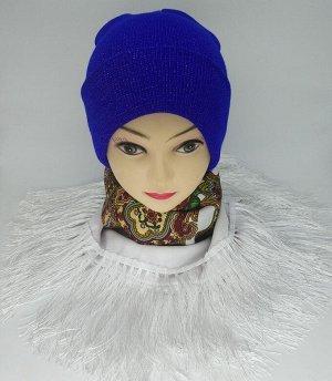 Шапка СТАРАЯ ЦЕНА 195 рублей!   Вязанная шапка с люрексной нитью на девушек, удлиненной модели, имеет широкий отворот.Стильная женская шапка хорошо смотрится с пуховиками и будет интересно сочетаться