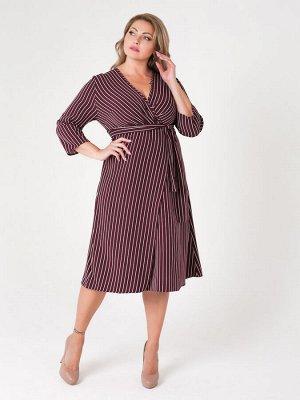 Платье на мой взгляд- маломерит Эффектное платье-миди для гардероба полных женщин. Модель на запах с глубоким декольте и завышенной талией. Женственный крой, комфортная посадка по фигуре, выгодная дли