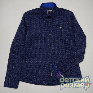 Рубашка Рубашка для мальчиков:- выполнена из качественного плотного текстиля- застегивается по всей длине на удобные пуговицы- украшена мелким лаконичным рисунком, надписью на груди и контрастными дет