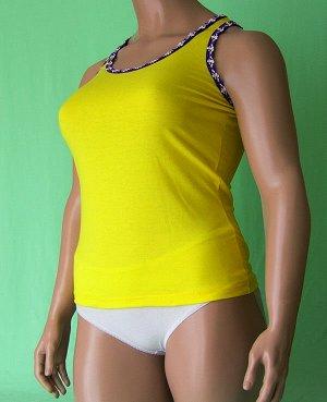 Майка Майка на узкой бретельки из высококачественного хлопка с отделкой фиолетовые цветочки на белом, оранжевом и желтом фоне . Хлопок 100%. Цвет желтый