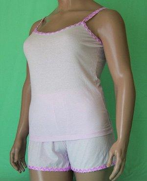 Комплекты Комплект майка на бретельке с волнистой отделкой розового цвета и шорты с такой же отделкой. Хлопок 100%. Цвет комплекта ментоловый, белый, розовый. В комментарии указывайте цвет, который ну