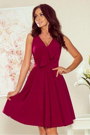 Платье NUMOCO 274-1  Платье-клёш с оборкой спереди. Состав: 95% полиэстер, 5% эластан. Рост модели на фото 170 см.