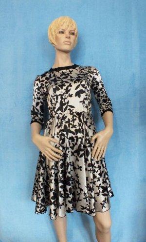 Платье Материал искусственный шелк. Рукава 41 см,  Длина 83 см, ОГ 86 см, ОТ 73 см. Имеет небольшой складской запах, при стирке уходит