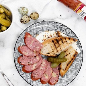Пряные колбаски с сыром п/к Продукт мясной ст.вес 250 г
