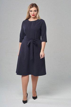 Платье Офисное платье из качественной костюмной ткани. По переду застрочены декоративные складки.Рукав втачной 3/4 длины.Юбка слегка расклешена,с карманами в боковых швах.В среднем шве спинки потайная