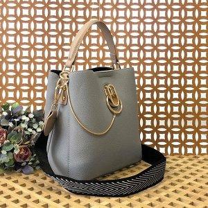 Классическая сумочка Omnia_Gold с широким ремнем через плечо из матовой эко-кожи дымчато-голубого цвета.