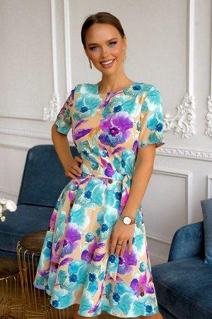 Платье Размер: 42 / 44 / 46 / 48 Красивое платье из легкого текстильного полотна. Сзади замок 50 см Эксклюзивный дизайн ткани . Летнее платье в многочсленных ярктх оттенках! Платье украшают разлетевши
