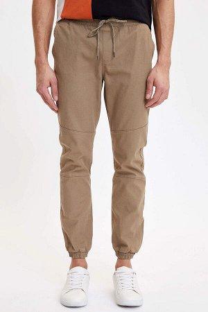 брюки Размеры модели: рост: 1,88 грудь: 98 талия: 80 бедра: 98 Надет размер: 32  Хлопок 97%,Elastan 3%