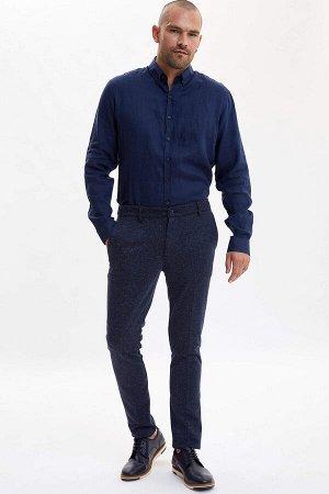 брюки Размеры модели: рост: 1,82 грудь: 98 талия: 81 бедра: 96 Надет размер: размер 32 - рост 32  Вискоз 31%, Полиэстер 65%,Keten 4%