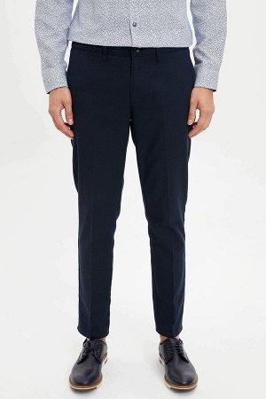 брюки Размеры модели: рост: 1,82 грудь: 98 талия: 81 бедра: 96 Надет размер: размер 32 - рост 32 Elastan 1%, Вискоз 8%, Полиэстер 44%, Хлопок 47%