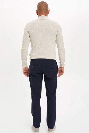 брюки Размеры модели: рост: 1,89 грудь: 98 талия: 80 бедра: 95 Надет размер: размер 32 - рост 32  Вискоз 33%, Полиэстер 62%,Elastan 5%