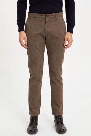брюки Размеры модели: рост: 1,89 грудь: 99 талия: 75 бедра: 99 Надет размер: размер 30 - рост 32  Хлопок 67%,Elastan 1%, Полиэстер 32%
