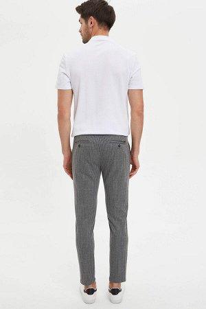 брюки Размеры модели: рост: 1,89 грудь: 100 талия: 74 бедра: 97 Надет размер: размер 32 - рост 32  Хлопок 12%, Полиэстер 84%,Elastan 4%