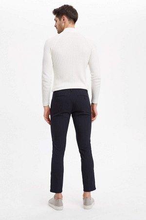 брюки Размеры модели: рост: 1,88 грудь: 99 талия: 80 бедра: 97 Надет размер: размер 30 - рост 30  Вискоз 34%, Полиэстер 63%,Elastan 3%
