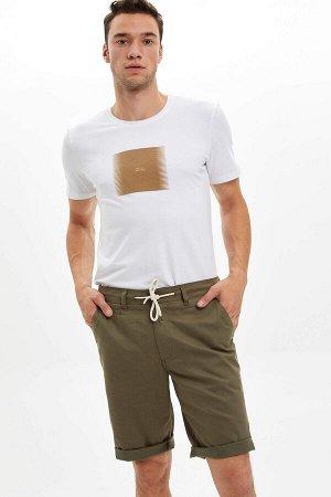 шорты Размеры модели: рост: 1,85 грудь: 96 талия: 80 бедра: 95 Надет размер: 30  Хлопок 81%,Keten 6%,Lyocell 13%