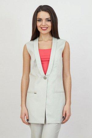 Жилет Удлиненный жилет с застежкой на одну пуговицу – отличный вариант для создания летнего брючного костюма. Последний прочно удерживает позиции на модных подиумах, помогая женщинам создавать элегант