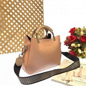 Дизайнерская сумочка Telyviv с широким ремнем через плечо из матовой эко-кожи пудрового цвета.