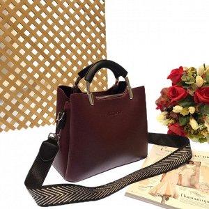 Дизайнерская сумочка Telyviv с широким ремнем через плечо из матовой эко-кожи сливового цвета.