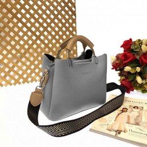 Дизайнерская сумочка Telyviv с широким ремнем через плечо из матовой эко-кожи дымчато-голубого цвета.